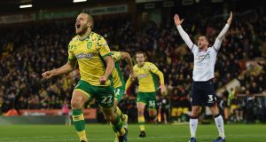Norwich City's Teemu Pukki celebrates scoring his side's third goal of the game during the Championship win over Bolton. Photo: Daniel Hambury/PA Wire