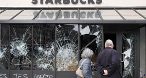 Graffiti is seen on a vandalised Starbucks coffee shop following protests in Paris, France. Photograph: REUTERS/Piroschka van de Wouw