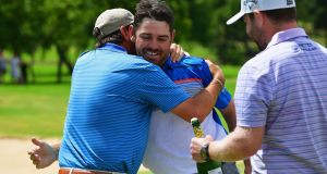 Louis Oosthuizen of South Africa (C) is congratulated by Thomas Aiken  and Branden Grace after victory in the final round on day four of the South African Open at Randpark Golf Club in Johannesburg, South Africa. Photo: Stuart Franklin/Getty Images