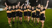 Mourneabbey players celebrate with the Dolores Tyrrell Memorial Cup after beating Foxrock-Cabinteely in the All-Ireland Ladies Football Senior Club Championship Final   at Parnell Park in Dublin. Photograph: Stephen McCarthy/Sportsfile