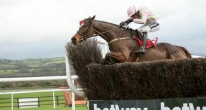 Min and Ruby Walsh en-route to landing the John Durkan at Punchestown. Photograph: Laszlo Geczo/Inpho