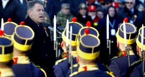 Romanian president Klaus Iohannis salutes the honour guard during a military parade marking 100th Romania's Great Union Day, in Bucharest. Photograph: Robert Ghement/EPA