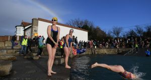 CHARITY SWIM: Swimmers take part in a charity event called the 'Polar Plunge' at Sandycove in Co Dublin, in support of the Special Olympics. Photograph: Clodagh Kilcoyne/Reuters