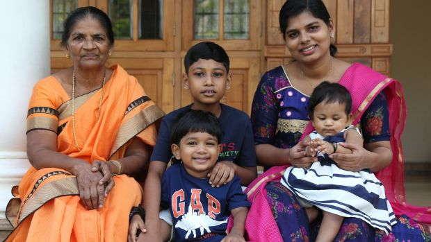 Bindu Jojo (right) with her children and mother Mary at their house in Angamaly on the outskirts of Kochi City, Kerala. Photograph: Sivaram V