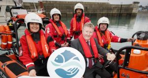 Minister of State for Natural Resources Seán Canney and Inland Fisheries Ireland staff mark the International Year of the Salmon with the unveiling of one of a new fleet of 12 RIBs at Greystones, Co Wicklow.