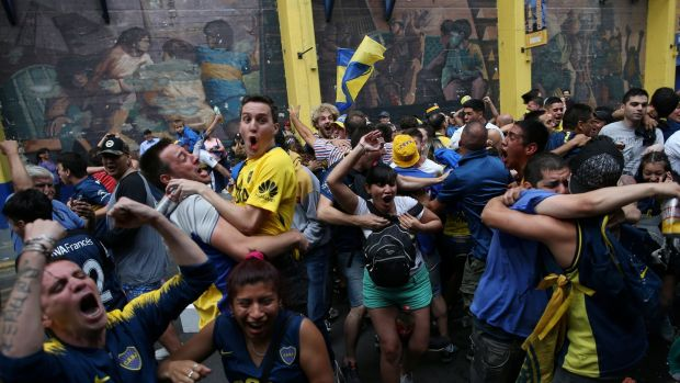 Boca Juniors fans in Buenos Aires celebrate their first goal. Photo: Agustin Marcarian/Reuters