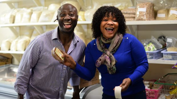 Felix Ajayi, a supplier of pastries, and Cynthia Okonkwo on Parnell Street, Dublin. Photograph: Dara Mac Donaill