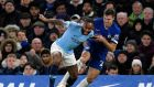 Chelsea's Cesar Azpilicueta tackles Raheem Sterling during the Premier League meeting at Stamford Bridge. Photo: Will Oliver/EPA