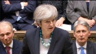 Theresa May jeered as she postpones key Brexit vote
