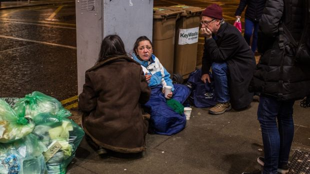 The outreach team from the Simon community group speak to a homeless woman on Dame Street in Dublin. Photograph: James Forde