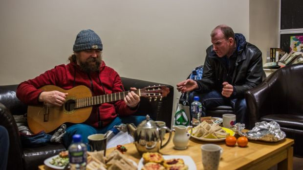 Two homeless men play music and sing at a social club event at the Simon community centre in Dublin. Photograph: James Forde