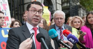Senator Ronan Mullen (left) and  Mattie McGrath TD, with pro-life supporters behind, speaking to the media on Kildare Street, Dublin on October 12th, 2017 Photo: Gareth Chaney Collins