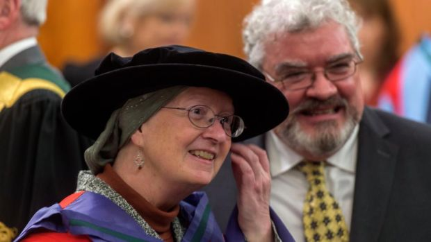 Adrienne Cullen receiving her Honorary Doctorate of Laws from University College Cork, with her husband Peter Cluskey on December 10th. A UCC sociology and philosophy graduate, Cullen has described the parallels between her own story and that of Vicky Phelan as 'striking and deeply disturbing' Photograph: Michael Mac Sweeney/Provision