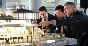 Minister for Housing Eoghan Murphy with Brian Moran, senior managing director with Hines (right), and Paul van Stiphout, senior portfolio manager at APG Asset Management, at the announcement of the construction of  new apartments at Cherrywood town centre in Dublin. Photograph: Dara Mac Dónaill