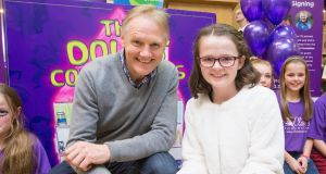 Author Keeva Heffernan (12) with  Ireland rugby coach Joe Schmidt on Monday. All proceeds from her book,  The Dolls' Complaints, will go to the charity Cliona's Foundation. Photograph: Liam Burke/Press 22