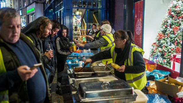 Volunteers from the Mobile Homeless Run hand out food on Grafton Street in Dublin. Photograph: James Forde/The Irish Times