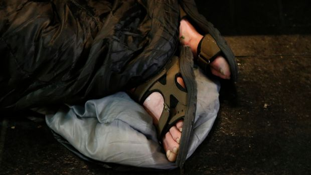The feet of a rough sleeper seen outside the GPO on O'Connell Street in Dublin. Photograph: Nick Bradshaw/The Irish Times