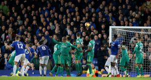 Everton's Lucas Digne scores their second goal from a free kick during the Premier League encounter with Watford. Photo: Andrew Yates/Reuters
