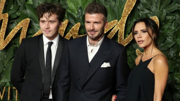 Victoria Beckham with husband, former English international footballer David Beckham and son Brooklyn at the British Fashion Awards 2018 in London on Monday. Photograph: Daniel leal-Olivas/AFP/Getty Images