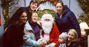Khushbu Shah (front left) with her husband and his family visiting Santa in Cork.