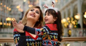 Serene Ibraheem (4) and her mother Raneem, from Syria, in St Stephen's Green Shopping Centre, Dublin. They have been living in Ireland since 2015. Photograph: Dara Mac Dónaill/The Irish Times