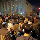 Rabbi Jeffrey Myers leads a gathering in Hanukkah songs outside the Tree of Life synagogue on the first night of Hanukkah, on Sunday, December 2nd, 2018. Photograph: Gene J Puskar