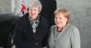 Theresa May (L) shakes hands with Angela Merkel ahead of talks at the Chancellery in Berlin on Tuesday. Photographer: Krisztian Bocsi/Bloomberg