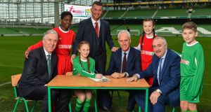FAI chief John Delaney;  Murphy Alade, (11) from Irishtown; Éabha Seery (12) from Clondalkin; Colin Bell, Republic of Ireland women's team manager; Mick McCarthy, Republic of Ireland manager, Alex Carrick, (12) from Clondalkin; Leo Crawford, BWG Group chief executive, and Cameron Tormey (11) from Lucan at the Aviva. Photograph: Seb Daly/Sportsfile