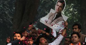 Congress Party workers celebrate the party's lead in votes counting and potential victory in assembly elections, with a cutout of party president Rahul Gandhi at party headquarter in New Delhi, India. Photograph: Rajat Gupta/EPA
