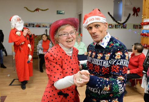 FANCY FOOTWORK: Margaret Farrell dances with Christopher Reid during the Friends of the Elderly Christmas Party on Bolton Street, Dublin. Photograph: Dara Mac Donaill/The Irish Times