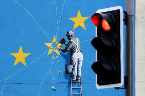 "SMASH EU: A view of Banksy's Brexit mural in Dover, Kent, of a man chipping away at the EU flag. British prime minister Theresa May is to bring her Brexit deal back to the House of Commons ""before January 21st"", her official spokesman has said, after a vote on it was deferred. Photograph: Gareth Fuller/PA Wire"