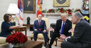 US president Donald Trump  argues about border security with senate minority leader Chuck Schumer (right) and incoming House majority leader Nancy Pelosi as vice-president Mike Pence looks on in the Oval Office in Washington, DC. Photograph: Mark Wilson/Getty Images