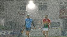 Dublin's Chris Crummy and Jack Murphy of Carlow during the Walsh Cup match at  Netwatch Cullen Park in Carlow. Photograph: James Crombie/Inpho