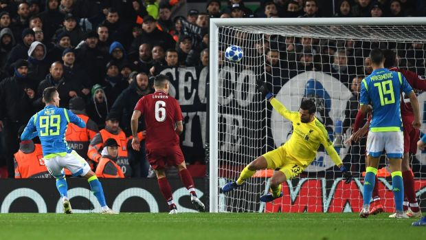 Liverpool goalkeeper Alisson Becker saves a shot from Napoli's Arkadiusz Milik late in the game. Photograph: Paul Ellis/AFP/Getty Images