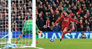 Liverpool's Mohamed Salah  scores his side's first goal of the game during the  Champions League match against Napoli at Anfield. Photograph:  Peter Byrne/PA Wire