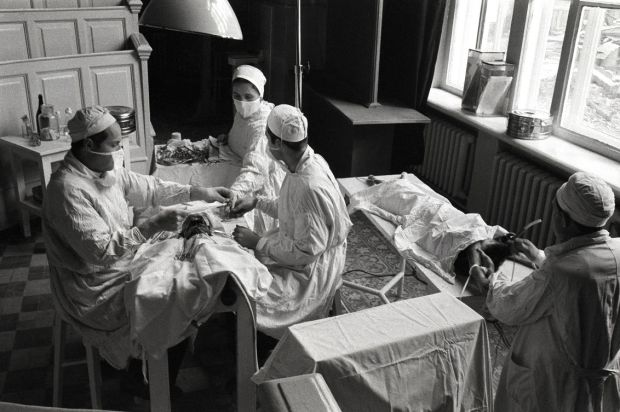 In 1958, Radio Moscow described a new surgical device that apparently made possible the grafting of a head of a puppy on to a fully grown dog. This photo shows the operation in progress. The transplant was led by Soviet surgeon Vladimir Demikhov at the Moscow Medical Institute.