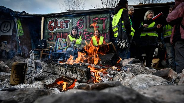 Yellow vest (Gilets Jaunes) protestors occupy a traffic circle, on December 11th in Saint-Etienne. Photograph: AFP/Getty Images
