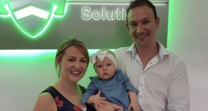 Andrew Harte with his wife Denise and their daughter at the offices of his   company   Eire Workforce Solutions in Australia