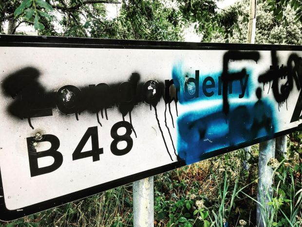 Ulster cycle: a defaced Londonderry sign