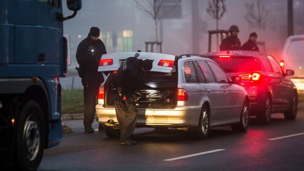 Police search cars on the border between Germany and France in Kehl, southern Germany, on Wednesday.Photograph: AP