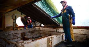 Crew members Conor Lynch and Shane Harrington at work on board the fishing vessel Eblana. Photograph: Bryan O'Brien