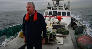 "John Lynch, skipper of the fishing vessel Eblana: ""Fish don't do borders. They have tails; they move."" Photograph: Bryan O'Brien"