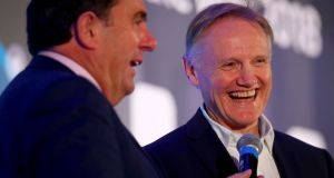 Des Cahill talks to Ireland rugby coach Joe Schmidt after he was named Philips Sports Manager of the Year at an awards ceremony at the InterContinental Hotel in Dublin. Photograph: Tommy Dickson/Inpho