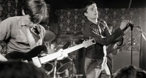 Bernard Sumner and  Ian Curtis performing live onstage at Bowdon Vale Youth Club Photograph:  Martin O'Neill/ Redferns