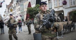 Soldiers patrol near the Christmas market where, on Tuesday, a man shot 14 people, killing at least two people.  Photograph: homas Lohnes/Getty Images