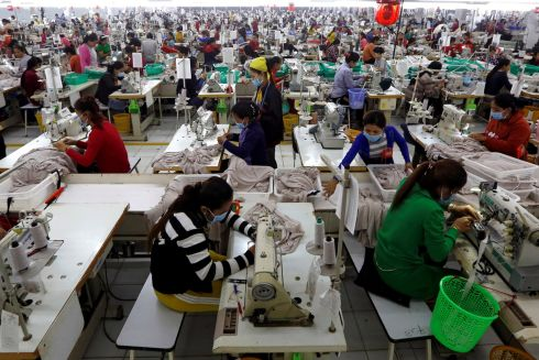 NOSE TO THE GRINDSTONE: Employees work at a factory supplier of the H&M brand in Kandal province, Cambodia. Photograph: Samrang Pring/Reuters