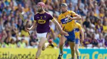 Paudie Foley of Wexford and Clare's Cathal Malone  during their quarter-final clash in  Páirc Uí Chaoimh, Cork, in July. Photograph: Tommy Dickson/Inpho