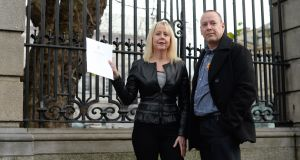 Eileen O'Sullivan and Ramon Whelan outside Leinster House on Wednesday after the launch of new legislation to crack down on advertising of false cancer cures. Photograph: Dara Mac Dónaill
