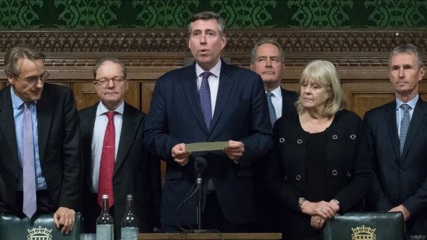 Graham Brady (holding paper), chairman of the 1922 Committee, announces that Theresa May has survived an attempt by Tory MPs to oust her as party leader, at the Houses of Parliament in London. Photograph: Stefan Rousseau/PA Wire