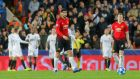 Manchester United's Phil Jones after scoring an own goal against Valencia. Photograph: Heino Kalis/Reuters